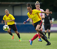 Natalie Murray of Watford Ladies is brought down by Danielle Maloney of Stevenage Ladies during the pre season friendly match between Stevenage Ladies FC and Watford Ladies at The County Ground, Letchworth Garden City, England on 16 July 2017. Photo by Andy Rowland / PRiME Media Images.