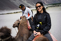 Suzanne Lee filming a camel ride with the Sony ActionCam POV cameras while on a motorcycle ride Across the Indian Himalayas with Sanjit Das on Royal Enfield motorcycles. Photo by Sanjit Das/Panos Pictures