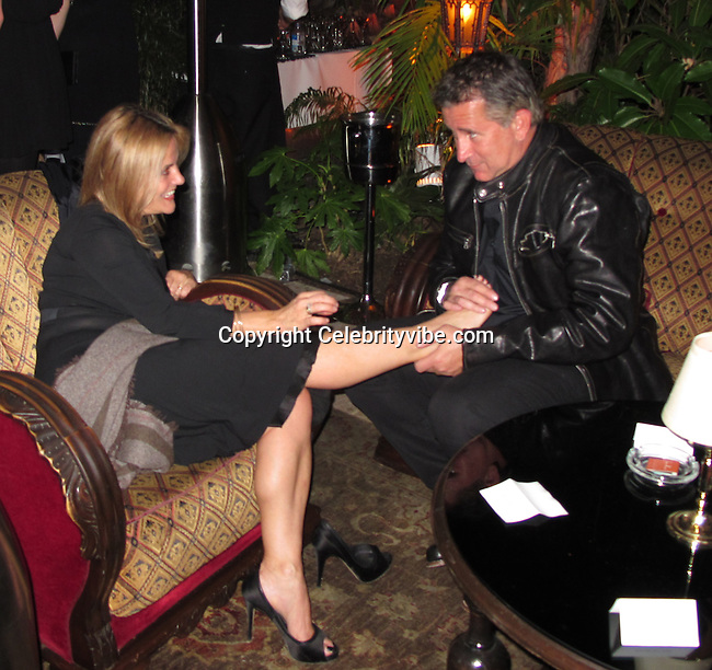 "**EXCLUSIVE**.Anthony LaPaglia and Jennifer..Anthony LaPaglia massages Jennifer's feet..The Weinstein Co. Party for OSCAR Nominated movie ""The King Speech"".Chateau Marmount Hotel..Hollywood, CA, USA..Monday, January 07, 2011..Photo By CelebrityVibe.com..To license this image please call (212) 410 5354; or .Email: CelebrityVibe@gmail.com ; .website: www.CelebrityVibe.com"
