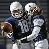 Oceanside quarterback No. 18 Vincent Guarino, left, gets congratulated by No. 5 Nick Mari after he ran for a 2-yard touchdown in the second quarter of the Nassau County varsity football Conference I final against Farmingdale at Hofstra University on Saturday, Nov. 21, 2015.<br /> <br /> James Escher