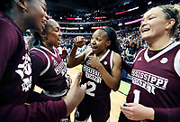 Mississippi State University women's basketball players celebrate together after Morgan William's buzzer-beating shot clinched a 66-64 victory over the University of Connecticut in the Final Four. The Bulldogs will play the University of South Carolina on Sunday [April 2] for the national championship in Dallas. MSU will host a watch party at Humphrey Coliseum for the game.<br />