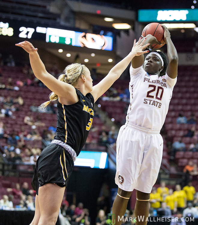Florida State forward Shakayla Thomas shoots over Missouri guard Sophie Cunningham during the second half of a second-round game of the NCAA women's college basketball tournament in Tallahassee, Fla., Sunday, March 19, 2017. Florida State defeated Missouri 77-55. (AP Photo/Mark Wallheiser)