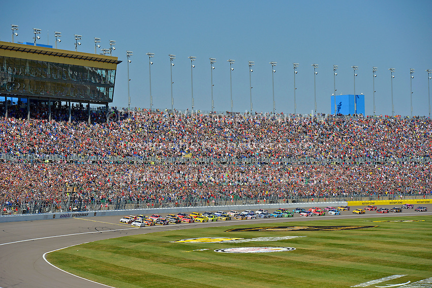 Polesitter Brad Keselowski (#2) and Carl Edwards, (#19) lead the field at the start