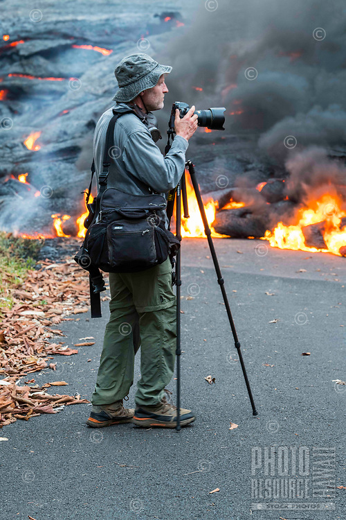 May 2018: A photographer takes photos of the Kilauea Volcano eruption in Leilani Estates, Puna, Big Island of Hawai'i.