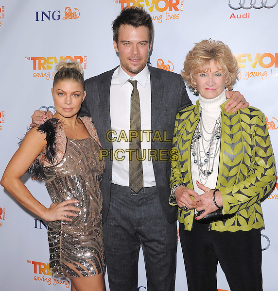 Stacy Ferguson - Fergie of Black Eyed Peas & Josh Duhamel & his mother, Bonny.Trevor Live at The Hollywood Palladium in Hollywood, California, USA..December 4th, 2011  .half length dress  grey gray suit married husband wife  backless black pink beige feathers hair up bun hand on hip trousers green print jacket in-law mom mum son family  sequins sequined  .CAP/RKE/DVS.©DVS/RockinExposures/Capital Pictures.