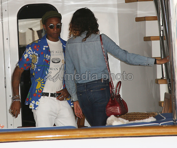 22 May 2015 - Cannes, France - Pharrell Williams, Helen Lasichanh. Pharrell Williams and Helen Lasichanh during The 68th Annual Cannes Film Festival. Photo Credit: Andre Mischke/face to face/AdMedia