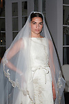 Marianna poses in a cream brocade high low bridal gown with Monvieve veil, from the Barbara Tfank Fall Winter 2019 collection on February 13, 2019 at The Elizabeth Collective during New York Fashion Week.