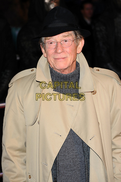 JOHN HURT.'Harry Potter And The Deathly Hallows: Part 1' world film premiere, Empire cinema Leicester Square and Odeon Leicester Square, London, England 11th November 2010.half length black hat beige trenchcoat glasses .CAP/CJ.©Chris Joseph/Capital Pictures.