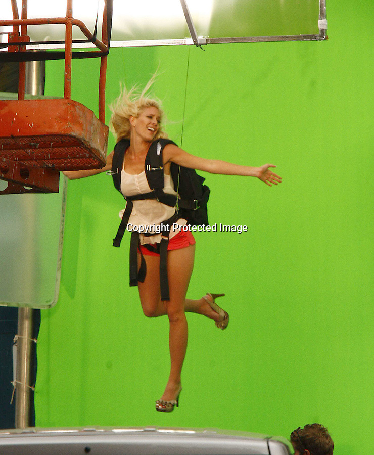 4-23-09.Heidi Montag with Spencer Pratt hainging from wires as they film a green screen promo for the upcoming season of I'm A Celebrity, Get Me Out Of Here in Los Angeles on Thursday...AbilityFilms@yahoo.com.805-427-3519.www.AbilityFilms.com.