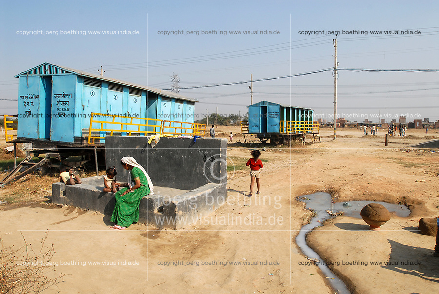 INDIA, New Delhi, forced shifted slum dweller at Slum Naglamachi at outskirts of Dehli, the people are mosty dalits, mobile toilets and washing facilities  / INDIEN  Neu Delhi , <br /> zwangs umgesiedelte Dalits im Slum Naglamachi am Stadtrand von Dehli