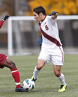 Virginia Tech defender Bradley Vorv (8) dribble is thwarted. Boston College (maroon) defeated Virginia Tech (Virginia Polytechnic Institute and State University) (white), 3-1, at Newton Campus Field, on November 3, 2013.