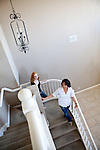 University of California, Merced students Jill Foster, left, and Heather Alarab, right, walk down the staircase in the spacious rental home they share in Merced, Calif., October 29, 2011.