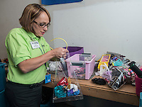 NWA Democrat-Gazette/ANTHONY REYES &bull; @NWATONYR<br /> Sarah Pine, assistant manager at Goodwill, sorts products Friday, Nov. 13, 2015 at the store in Springdale. Pine is a graduate of a job training program through Goodwill and has worked for the store for five years and has been promoted to assistant manager.