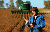 A farmer in soybean field during harvest season in Iowa.