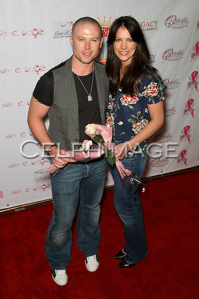 JACOB YOUNG, CHRISTEN STEWARD YOUNG.  Decked out in pajamas, celebrities arrive to Bowling After Dark, an event to benefit the Carol M. Baldwin Breast Cancer Research Fund, at Pinz Bowling Center in Studio City, CA, USA. February 13, 2010.