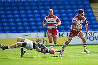 Freddie Burns of Gloucester Rugby wrong foots Tom Homer of London Irish during the Aviva Premiership match between London Irish and Gloucester Rugby at the Madejski Stadium on Saturday 8th September 2012 (Photo by Rob Munro)