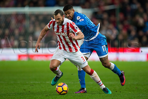 19.11.2016. Bet365 Stadium, Stoke, England. Premier League Football. Stoke City versus AFC Bournemouth. Stoke City defender Erik Pieters and Bournemouth midfielder Joshua King fight over a loose ball.