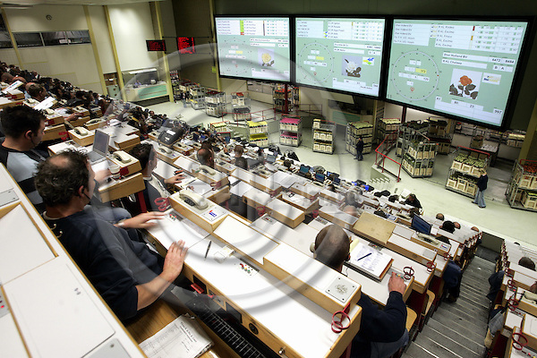 AALSMEER - NETHERLANDS - 20 OCTOBER 2004 -- The Flower Auction, Bloemenveiling Aalsmeer (VBA) a cooperative in the joint ownership of 3500 member growers. -- The auction room for rose buyers with the modern, computerised version of the auction clock projected on to screens.-- PHOTO:  EUP-IMAGES / JUHA ROININEN