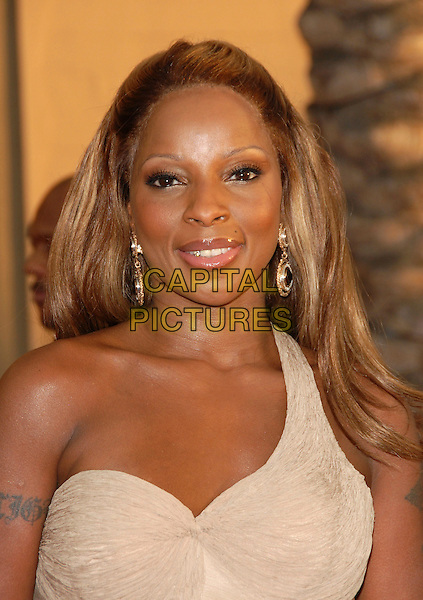 MARY J. BLIGE.The 34th Annual American Music Awards held at The Shrine Auditorium in Los Angeles, California, USA. - Arrivals.November 21st, 2006.headshot portrait earrings one shoulder tattoo cream.CAP/DVS.©Debbie VanStory/Capital Pictures