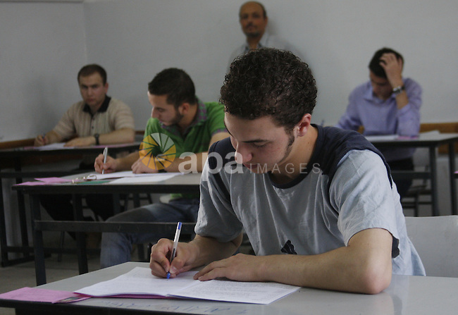 Students on the first day of the General Secondary Exams in Palestine School in the West Bank city of Hebron on June 12, 2010. Photo by Mamoun Wazwaz