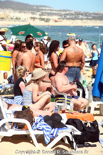 CROWED BEACH DURING SPREAK BREAK IN CABO SAN LUCAS