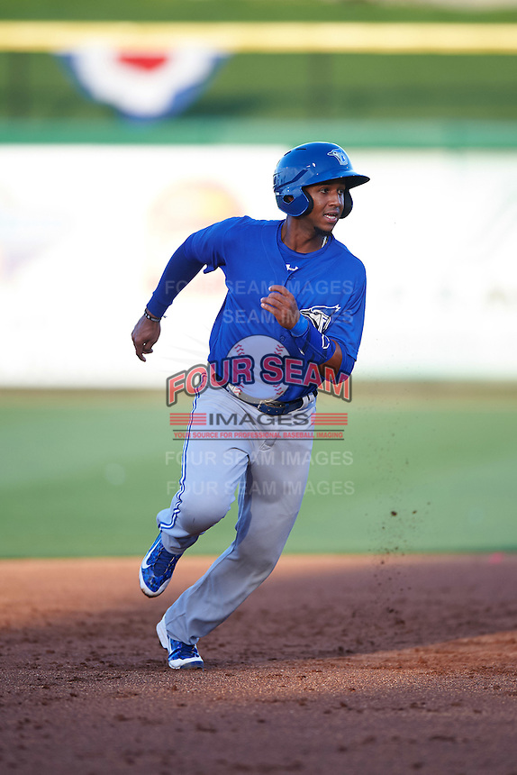 Dunedin Blue Jays shortstop Richard Urena (5) running the bases during a game against the Clearwater Threshers on April 8, 2016 at Bright House Field in Clearwater, Florida.  Dunedin defeated Clearwater 8-3.  (Mike Janes/Four Seam Images)