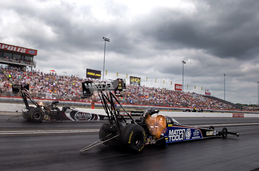 Sept. 1, 2013; Clermont, IN, USA: NHRA top fuel dragster driver Antron Brown (near) races alongside Shawn Langdon during qualifying for the US Nationals at Lucas Oil Raceway. Mandatory Credit: Mark J. Rebilas-