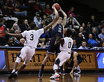 SIOUX FALLS, SD: MARCH 20:  Ty Rowell #22 of Cal Baptist gets pressure from Ike Agusi #0 and Shaun Willett #3 of Queens during their game at the 2018 Division II Men's Elite 8 Basketball Championship at the Sanford Pentagon in Sioux Falls, S.D. (Photo by Dick Carlson/Inertia)