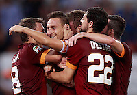 Calcio, Serie A: Roma vs ChievoVerona. Roma, stadio Olimpico, 18 ottobre 2014.<br /> Roma's Francesco Totti, second from left, celebrates with teammates after scoring on a penalty kick during the Italian Serie A football match between Roma and ChievoVerona at Rome's Olympic stadium, 18 October 2014.<br /> UPDATE IMAGES PRESS/Isabella Bonotto