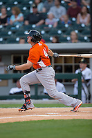 Chris Parmalee (41) of the Norfolk Tides follows through on his swing against the Charlotte Knights at BB&T BallPark on April 9, 2015 in Charlotte, North Carolina.  The Knights defeated the Tides 6-3.   (Brian Westerholt/Four Seam Images)