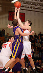 SIOUX FALLS, SD - JANUARY 21:  Sam Siganos #4 from Washington takes the ball to the basket against Jordan Terronez #22 from Watertown in the first half of their game Tuesday night at Washington. (Photo by Dave Eggen/Inertia)