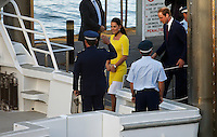 Prince William and his wife, Catherine the Duchess of Cambridge, leave the Opera House by boat after a reception hosted by the NSW Governor in Sydney, April 16, 2014. Photo by Daniel Munoz/VIEWPRESS
