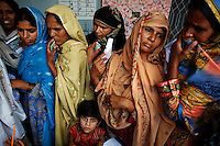 Women wait to vote at a polling station in a village near Lahore May 11, 2013. A string of militant attacks cast a long shadow over Pakistan's general election on Saturday, but millions still turned out to vote in a landmark test of the troubled country's democracy.    REUTERS/Damir Sagolj (PAKISTAN)
