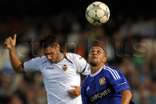 01.10.2011 Valencia, Spain.  Leverkusen's Sidney Sam (R) and Valencia's Victor Ruiz vie for the ball during the Champions League group E soccer match between Valencia CF and Bayer Leverkusen at the Estadi de Mestalla stadium in Valencia, Spain. Mandatory credit: ActionPlus