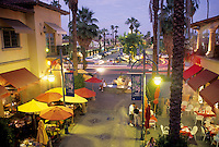 Dusk lighting people at Mercado Plaza Palm Springs California.