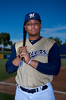 AZL Brewers Gold Jesus Chirinos (12) poses for a photo before an Arizona League game against the AZL Brewers Blue on July 13, 2019 at American Family Fields of Phoenix in Phoenix, Arizona. The AZL Brewers Blue defeated the AZL Brewers Gold 6-0. (Zachary Lucy/Four Seam Images)