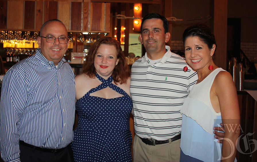 NWA Democrat-Gazette/CARIN SCHOPPMEYER Steve and Ann Zega (from left) and James and Angie visit at the 13th annual Red, White and Baby Blue on July 7 at The Garden Room in Fayetteville.