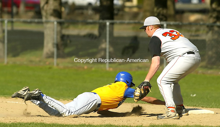 WINSTED, CT 4/30/07- 043007BZ08- Terryville's Pat Norton (32) makes the tag at first as Gilbert's Mitch Nichols (7) dives back to the bag<br /> during their game at Walker Field in Winsted Monday.<br /> Jamison C. Bazinet Republican-American