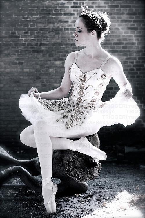 Female dancer wearing ballet tutu posing in profile