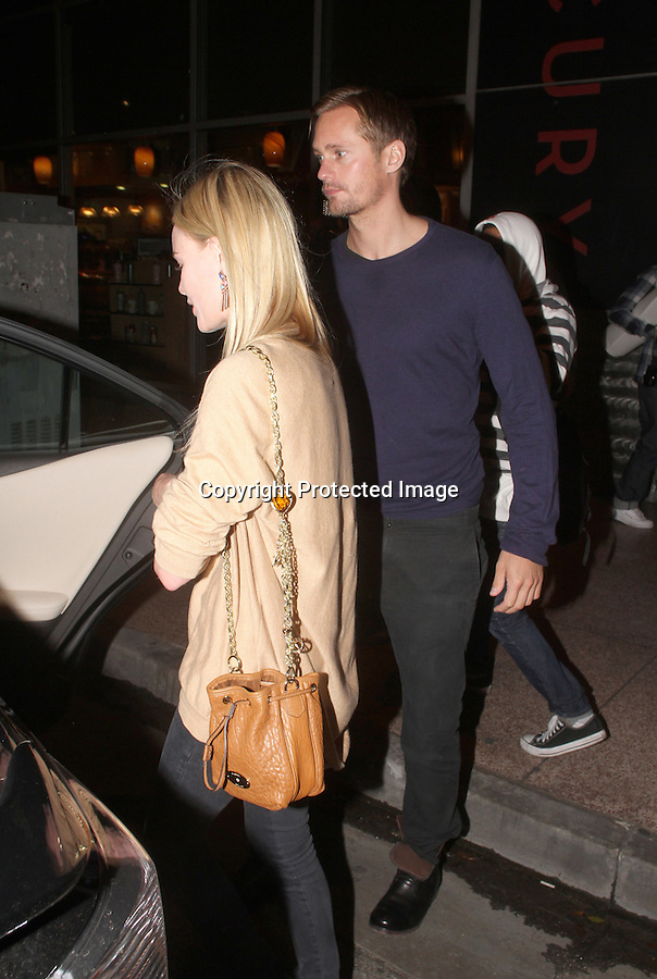 ..October 6th 2010  Wed night..First pictures of the couple back together .Kate Bosworth back together with her old boyfriend Alexander Skarsgard as they went on a date together. The couple watched a band called Broken Bells at the Wiltern theatre in Los Angeles. The couple separated once outside of the theatre. Kate was wearing a tan brown shirt & unzipped suede boots that matched Alexander's untied black boots. Kate also had on some colorful emerald blue pink & green earrings & a gold chain lizard ostrich skin purse bag .The couple seemed to have no interest in eating any of street hot dogs that surrounded them as they waited for there friends car to pick them up. ..AbilityFilms@yahoo.com.805-427-3519.www.AbilityFilms.com.