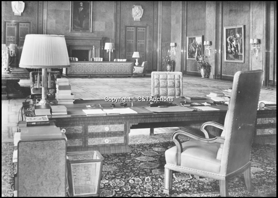 BNPS.co.uk (01202 558833)Pic: C&TAuctions/BNPS<br /> <br /> Hitlers Office before the war.<br /> <br /> Reich in Ruins - An incredible album of unseen photographs from Hitler's devastated Reich Chancellery, taken one of the first British soldiers into a devastated Berlin has come to light.<br /> <br /> The photo album was compiled by an elite soldier of the 1st Battalion Grenadier Guards that rolled into Berlin on 4th of July 1945. <br /> <br /> The photos show the inside of Hitler's spacious private office from behind his imposing desk and the conference hall where the Nazi high command met to plot their next move.<br /> <br /> By the time the unknown Guardsman set foot in the chancellery, its lavish marble interior had been battered by the Red Army assault and only a pile of rubble remained.<br /> <br /> The soldier composed an album of his own photographs alongside Nazi publicity postcards from the heyday of the Third Reich.