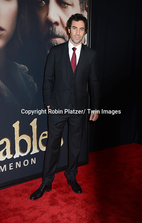 "Sacha Baron Cohen attends the American Premiere of ""Les Miserables"" on December 10, 2012 at the Ziegfeld Theatre in New York City. The movie stars Hugh Jackman, Anne Hathaway, Amanda Seyfried, Eddie Redmayne, Russell Crowe, Samantha Barks, Isabelle Allen and Sacha Baron Cohen."