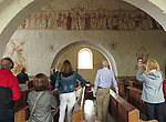 VMI Vincentian Heritage Tour: Members of the VMI tour the Saint-Germain church Thursday, June 30, 2016, located in La-Ferte-Loupière France. The church houses a rare Macabre Dances (Dance of Death) mural that stretches the length of the church. (DePaul University/Jamie Moncrief)