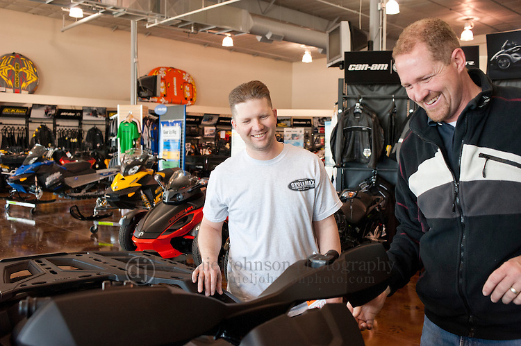 16 February 2012 --  Can-Am ATV Giveaway. Jason Moore of Omaha, left, talks with Bob Smith of Leisure Life Sports as Moore picks up his Can-Am ATV that he won as prize in Can-Am 4x4x4x4 Sweepstakes. Moore picked up his ATV at Leisure Life Sports in Omaha, Neb.. Picture by Daniel Johnson (Copyright 2012 Daniel Johnson)