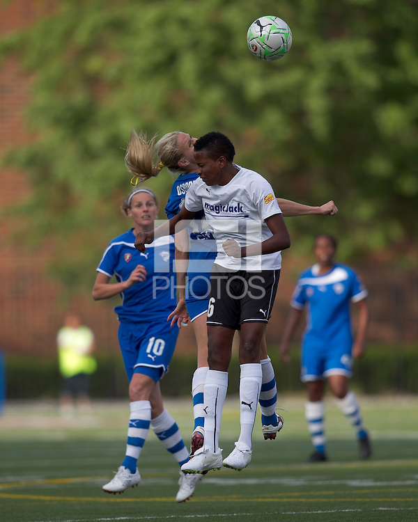 Boston Breakers midfielder Leslie Osborne (12) and magicJack midfielder Omolyn Davis (6) battle for head ball. In a Women's Professional Soccer (WPS) match, the Boston Breakers defeated magicJack, 2-1, at Harvard Stadium on June 5, 2011.