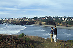 A couple looking over the bay at Mendocino, California
