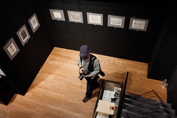 "Tokyo, June 10 2011 - The Japanese photographer Ryuichi Hirokawa visiting a gallery near ""Days japan"" magazine's office. M. Hirokawa is also editor in chief of the magazine."
