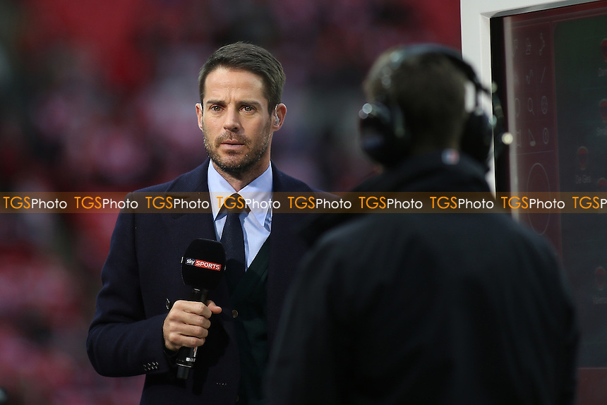 Jamie Redknapp waits for the nod to begin his live broadcast for Sky TV during Manchester United vs Southampton, EFL Cup Final Football at Wembley Stadium on 26th February 2017
