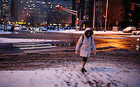 A woman walks  in Jersey City , as winter storm hits the tri-state area causing significant delays at airports in the region. Last month was coldest February in New York City since 1869. Mar 01,2015. Eduardo Munoz/VIEWpress.