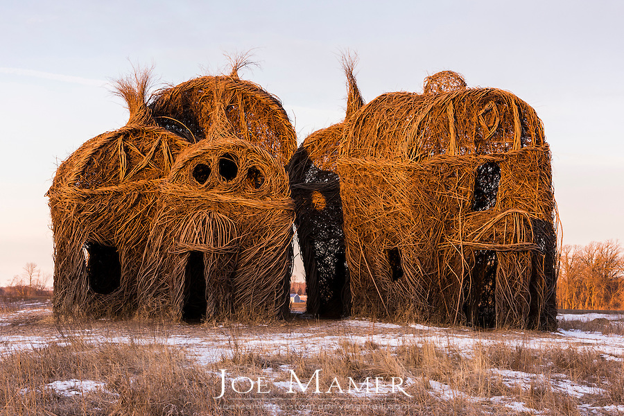 "Environmental artist Patrick Dougherty took up residence at the College of Saint Benedict / Saint John's University in September of 2012. During his time in the St. Cloud are he erected a large-scale outdoor sculpture made of sustainably harvested saplings from Saint JohnÕs Arboretum. The structure, called Lean On Me, consists of five small ""chapels"" huddled next to each other."